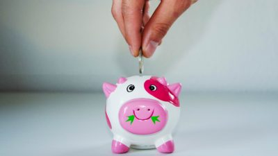 Saving money in a piggy bank